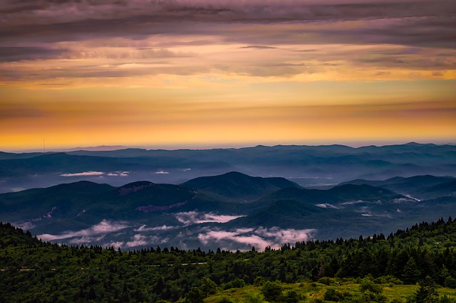 Photo of North Carolina Mountains at sunset with trees in foreground
