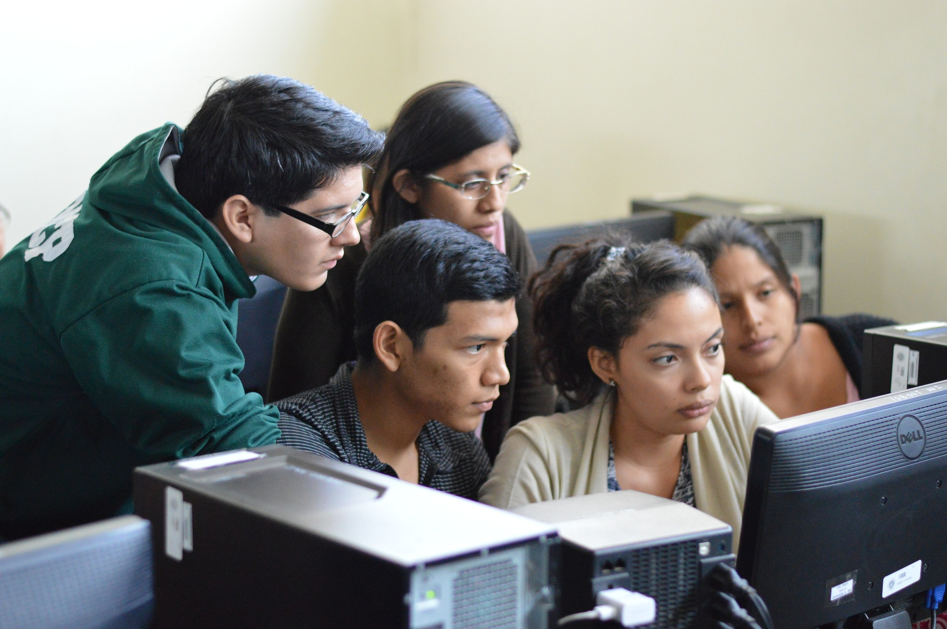 Hispanic and Latinx Students working collaborative at a computer in a computer lab.